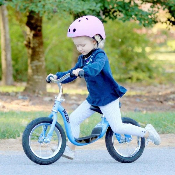 Girl on WeeRide Kazam Balance Bike