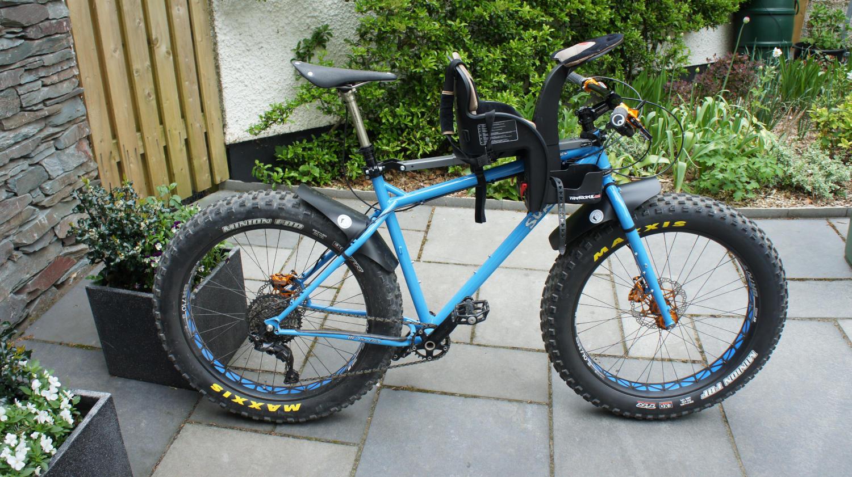 Fat whelled bike with child bike seat