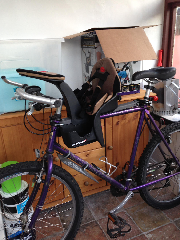 Hybrid bike with child bike seat attached